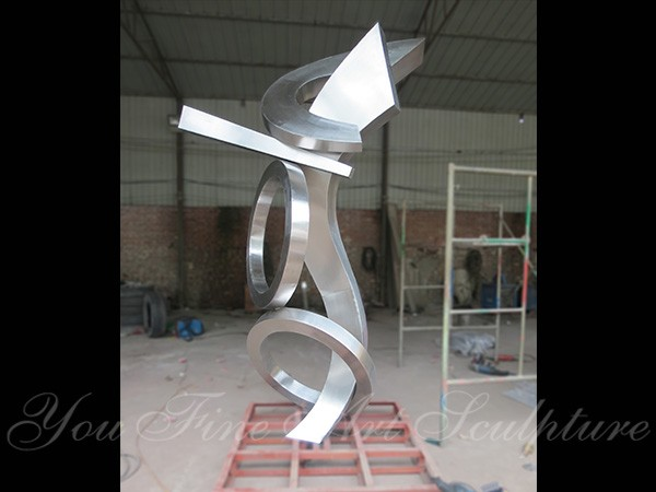 Large stainless steel clock sculptures